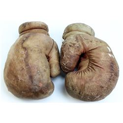 Old pair leather boxing gloves,