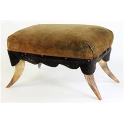 Horned foot stool with padded corduroy top,