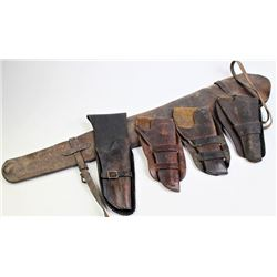 Collection of 4 holsters and rifle scabbard