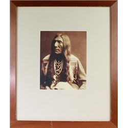 Framed and matted picture of an Indian man