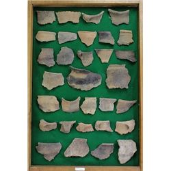Framed collection of pottery shards.