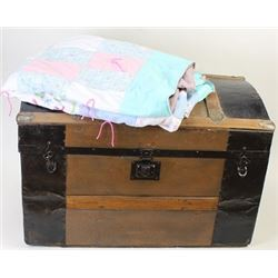 Collection of 2 includes dome top trunk and quilt.