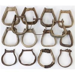 Collection of antique wooden saddle stirrups.