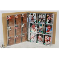 BINDER OF ASSORTED HOCKEY CARDS.