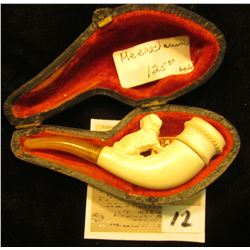 """Warranted Genuine Meerschaum"" miniature pipe in pipe case. Small dog on stem proximal to bowl."