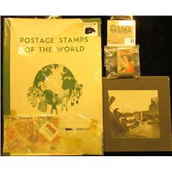 "Album ""Postage Stamps of the World"" with stamps & hinges.; B & W mounted photo of a Rail Road Bridge"