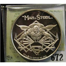 """Man of Steel"", ""Cartoon Celebrities Made in USA by AMC One Troy Oz. .999 Fine Silver"". Depicts Supe"
