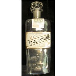 "Large 12 1/2"" x 4 1/4"" Clear Glass Apothecary Jar with label ""AG. Sulphuric"" and glass stopper. Chip"