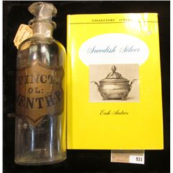 "9"" x 2 5/8"" Apothcary Jar with glass Stopper, no contents.  Labeled ""Tinct.OL: Menth: P:""; & a hardb"