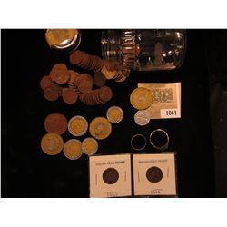 """1061 _ (59) 1930 era Wheat Cents in a baby food jar; (2) Indian Head Cents; """"Good Luck"""" Token; (8) M"""