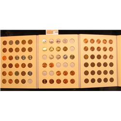 1375 _ A Littleton Lincoln cent folder with an unusual assortment of Wheat Cents, Steel Cents, Ename