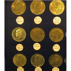 "1381 _ ""Dollars Miscellaneous"" Deluxe Whitman album with a partial Set of Eisenhower Dollars, which"