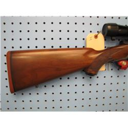 I... Ruger International Model 77 bolt action 308 fullwood 1.5 - 5 Leupold scope