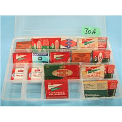 plastic container with miscellaneous primers some collector