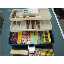 tackle box with assorted brass