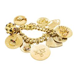 Charm Bracelet with Ten Attached Charms - 14KT Yellow Gold