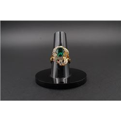 A Ring with Gemstone Inlay.