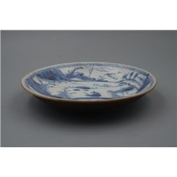 A Small Blue-and-White Plate with its External in Brown-Glazed Color.
