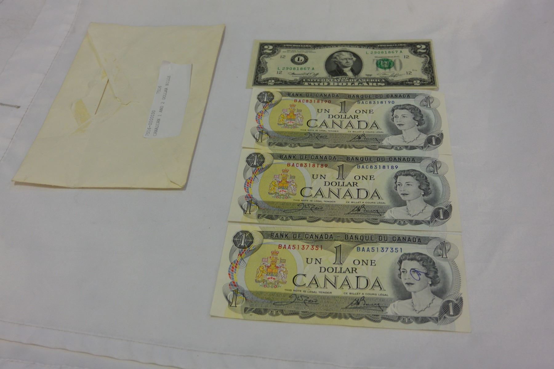 Image 1 Canadian Dollar Bills And Usa 2 Bill