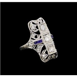 0.59 ctw Diamond and Sapphire Ring - Platinum