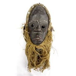 African Carved Wooden Mask with Whiskers
