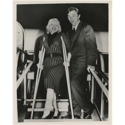 Marilyn Monroe (2) candid photographs, including 1-with Robert Mitchum and 1-with Arthur Miller.