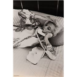 Marilyn Monroe wearing a Pucci print blouse photograph by George Barris.