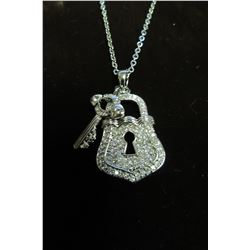 "SILVER AND CZ ACCENTED LOCK AND KEY PENDANT ON 17"" NECKLACE."