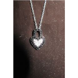 """HEART PENDANT ENCRUSTED WITH BLACK AND CLEAR CZ'S.  16"""" SILVER NECKLACE WITH 2"""" EXTENSION."""