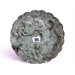 "Oriental antique bronze charger with scalloped edge, 9"" in diameter, 'Tiger and  the Dragon' charact"