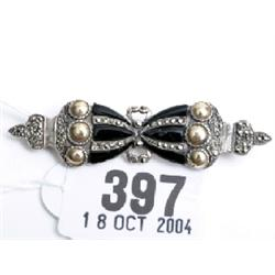 Onyx and marquisette bow brooch in silver