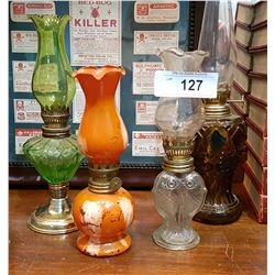 FOUR SMALL VINTAGE OIL LAMPS
