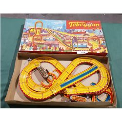 VINTAGE TIN TOBOGGAN PLAY SET IN ORIGINAL BOX