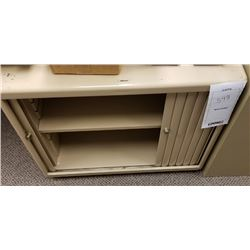 BEIGE METAL STORAGE CABINET WITH SLIDING DOORS AND ONE ADJUSTABLE SHELF