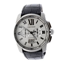 WATCH: [1] Stainless Steel Automatic Cartier wristwatch; Calibre de Cartier; Silver-tone dial with R