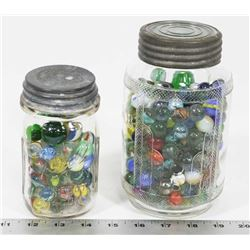 OLD JARS FILLED WITH VINTAGE MARBLES.