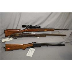 Three long guns including Lee Enfield #4 MKI, fitted with scope, missing bolt, Serial # A018046, a C
