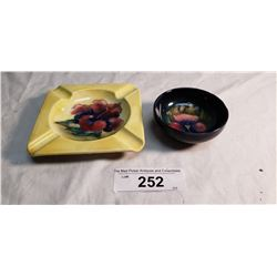1 Moorcroft Bowl , has 2 large chips colored in & 1 Moorcroft Ashtray w/ paper Label Potter to the Q