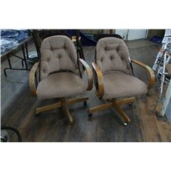 Two Oak Swivel Chairs - Upholstered Seats - On Wheels ** Must Pick up