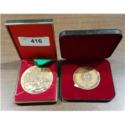 2 MEDALS IN THE PRESENTATION CASES