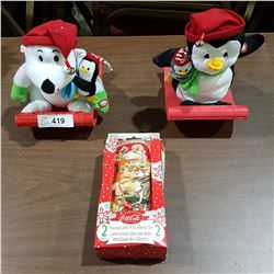 COCA-COLA PLAYING CARDS AND TWO CHRISTMAS FIGURES ON SLEDS