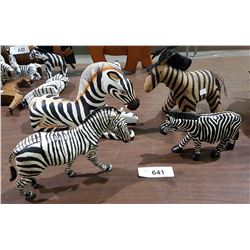 FOUR ZEBRA FIGURES
