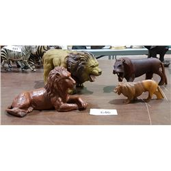 THREE CARVED WOOD LIONS & VINTAGE RUBBER BATTERY OPERATED LION