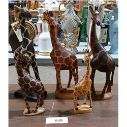 FIVE CARVED WOOD GIRAFFES