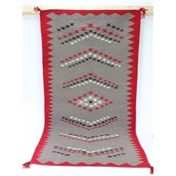 Finely woven contempered Navajo rug