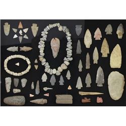 Framed display of early stone artifacts,