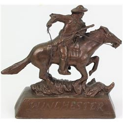 Vintage Winchester horse and rider metal statue