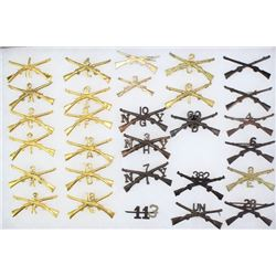 Collection of 29 crossed rifle artillery pins