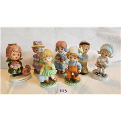 7 CHILD FIGURINES  1 figurine has broken arm