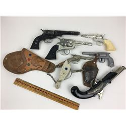LOT OF VINTAGE TOY GUNS, SPUR, LEATHER HOLSTERS ETC.